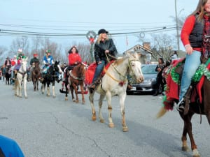 A long line of horses joined Saturday's Patrick County Christmas Parade on Main Street in Stuart. (Photo by Linda Hylton)