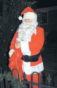 Santa Claus led the crowd Friday night on Main Street in a countdown to the Stuart Christmas Tree Lighting. County elementary school students made the ornaments. (Photo by Linda Hylton)